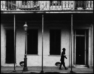 USA. New Orleans, Louisiana. 1958. Ernest Miller nicknamed Kid Punch Miller trumpet player and singer returning home at 6 am., by Dennis Stock