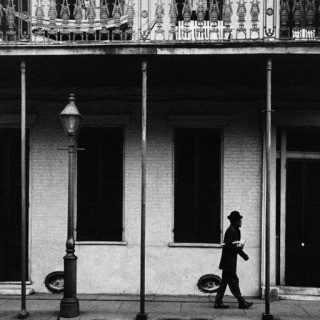 Dennis Stock, USA. New Orleans, Louisiana. 1958. Ernest Miller nicknamed Kid Punch Miller trumpet player and singer returning home at 6 am.