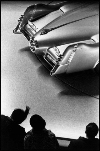 USA. New York City. 1953. Motorama car show, people looking at car., by Dennis Stock
