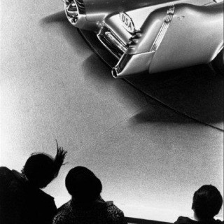 Dennis Stock, USA. New York City. 1953. Motorama car show, people looking at car.