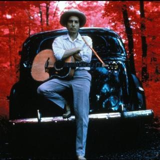 Bob Dylan, outside his Byrdcliffe home, infrared color film, Woodstock, NY, 1968. , by Elliott Landy