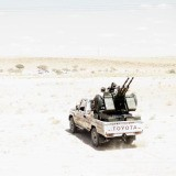 Moises Saman, Libya. Bani Walid. September 2011. Rebel fighters on a truck on the outskirts of Bani Walid, a Qaddafi stronghold
