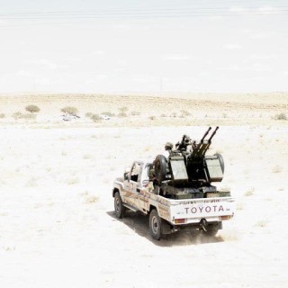 Libya. Bani Walid. September 2011. Rebel fighters on a truck on the outskirts of Bani Walid, a Qaddafi stronghold art for sale