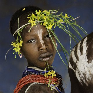 Child Adorned with Flowers, by Steve McCurry